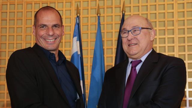 Sapin et le ministre des Finances grec // AFP