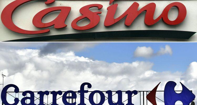 """Carrefour a sèchement démenti les """"insinuations inacceptables"""" de Casino, qui prétendait avoir été sollicité """"en vue d'une tentative de rapprochement"""". afp.com/Eric Eric Piermont, Loic Venance"""